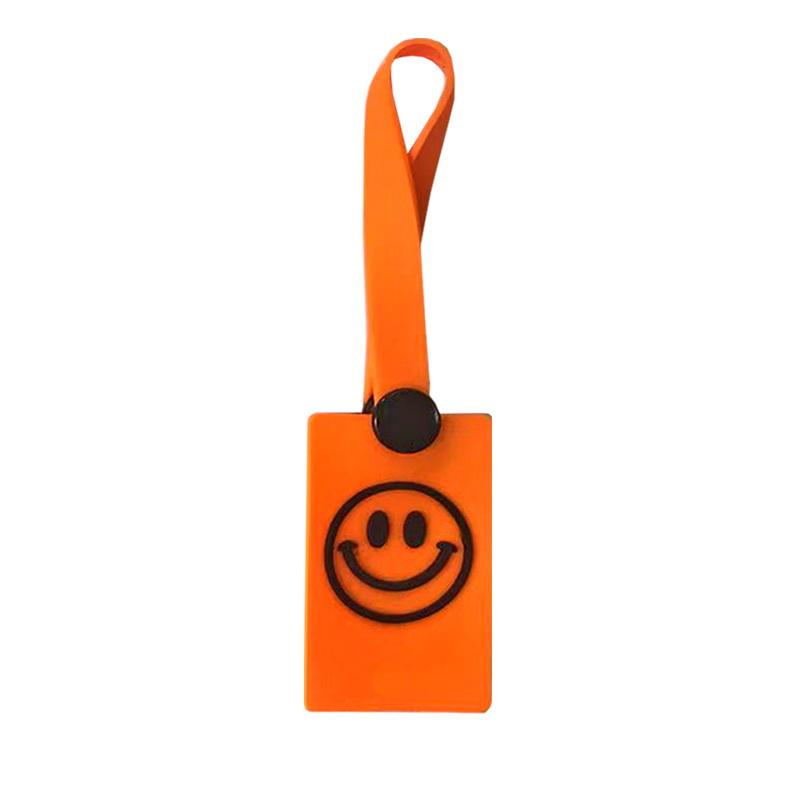 """Декоративная навеска силикон на петле с заклепкой """"Смайлик"""" 12*3,5см, цв:оранжевый/черный"""